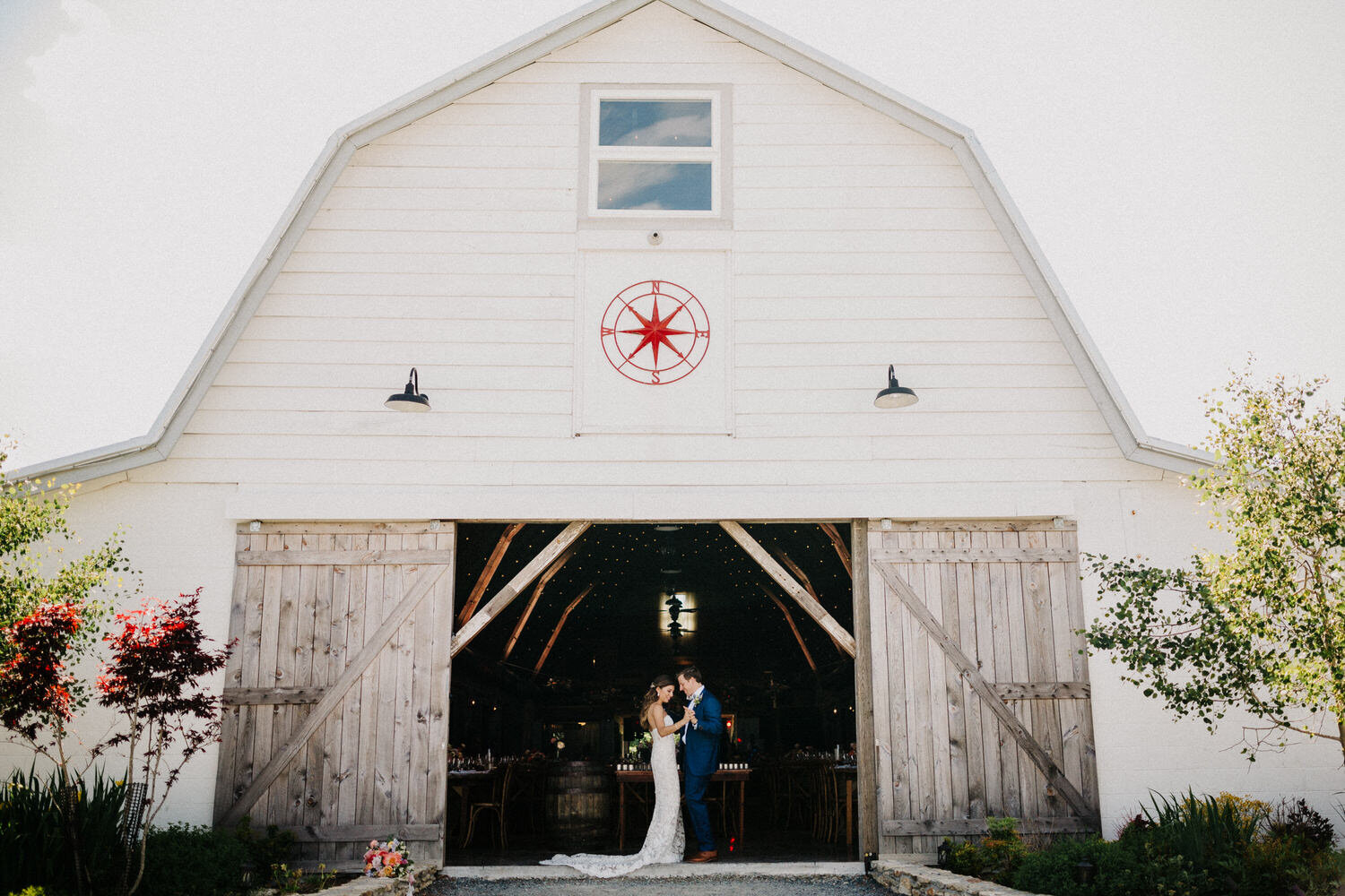A wedding couple is holding each other and is standing at the Overlook Barn in North Carolina.