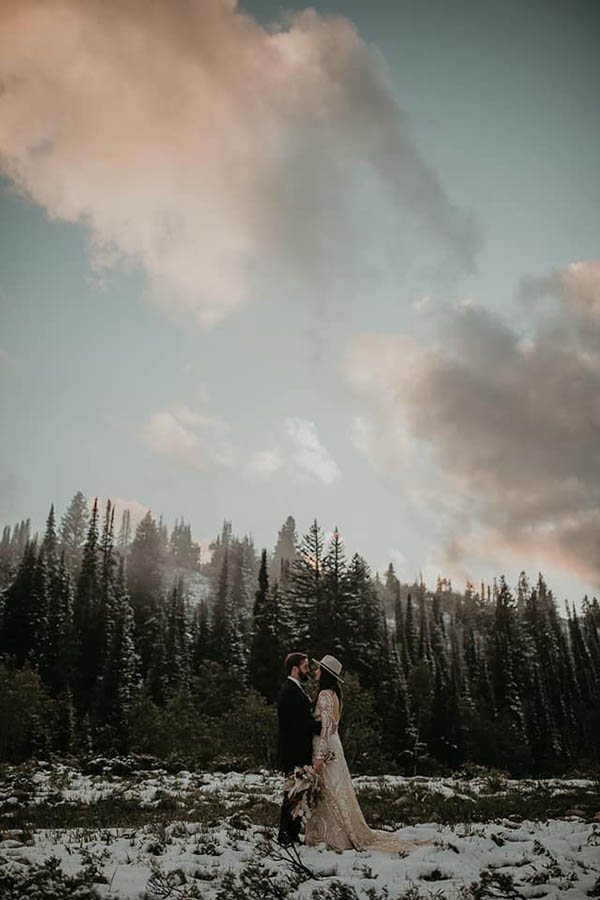 A wedding couple is holding each other at the Big Cottonwood Canyon in Utah.