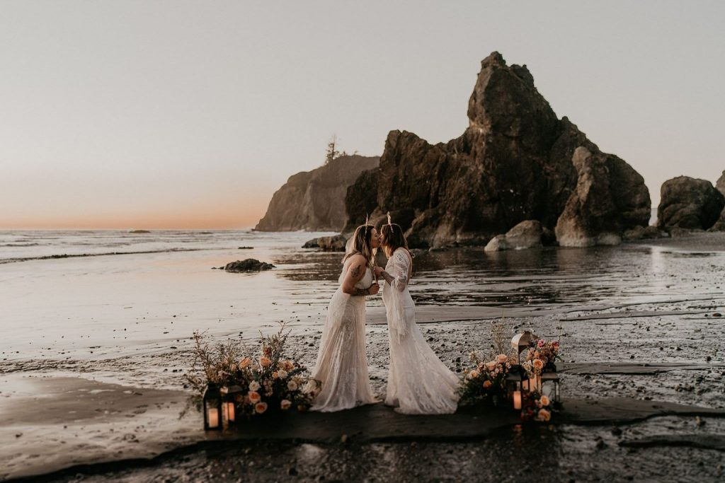 A wedding couple is kissing each other at Ruby Beach, one of the wedding venues Washington.