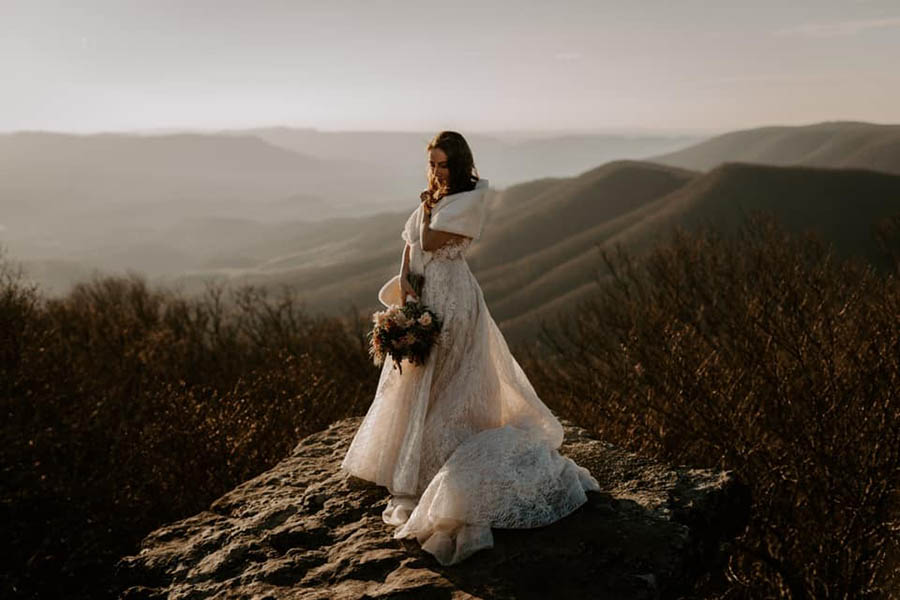 A bride is standing at the Appalachian Trail, one of the wedding venues in Virginia.