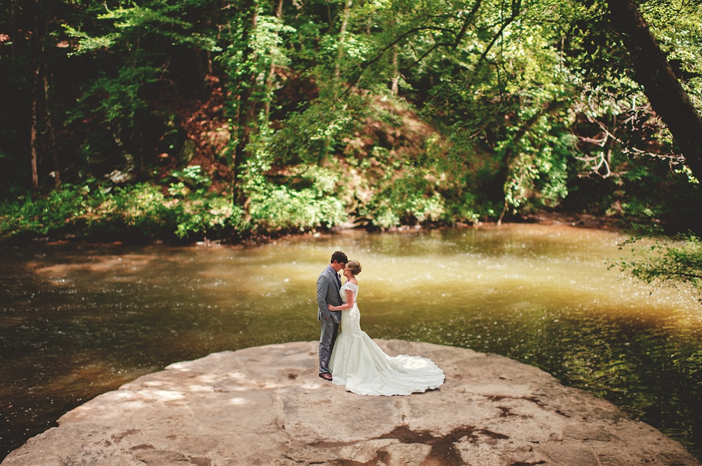 A wedding couple is holding each other at the Swann Lake Stables, Alabama.