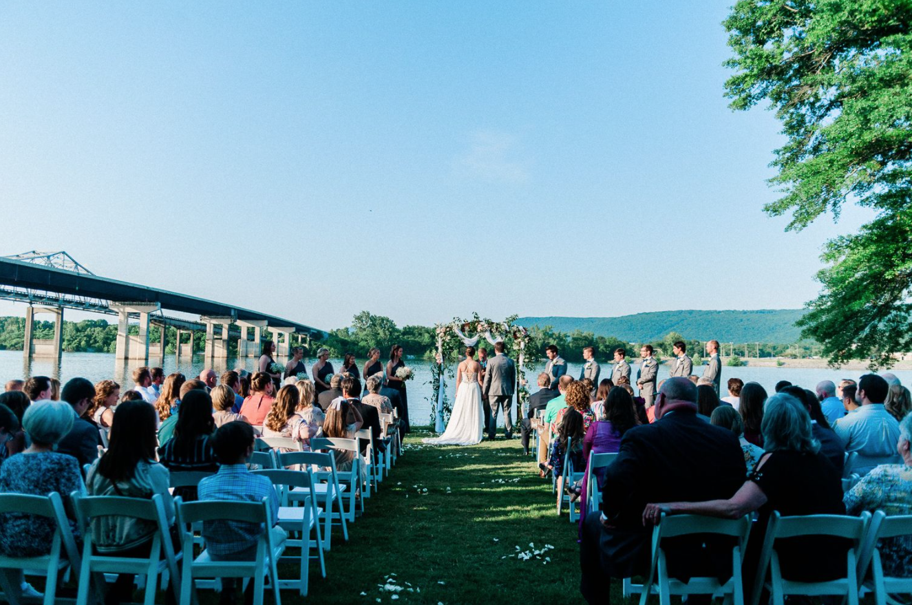 a wedding couple is getting married at the Riverside event venue near Huntsville, Alabama.