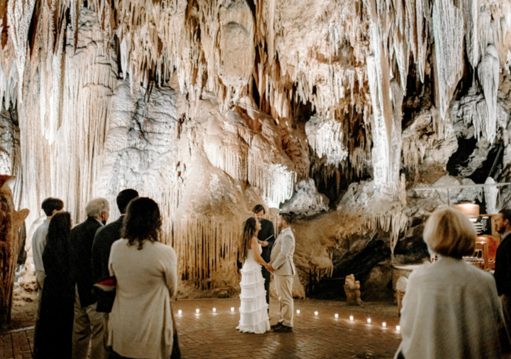 A wedding couple is getting married at Luray Caverns, one of the wedding venue in Virginia.