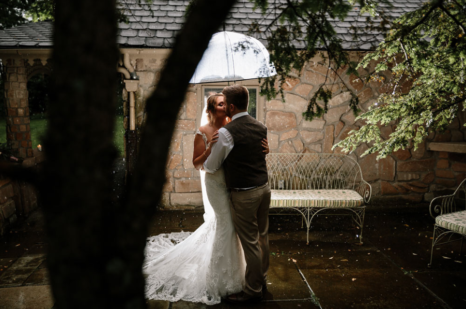 A wedding couple is kissing each other at the Hines Hill Conference Center in Cuyahoga Valley National Park, Ohio.