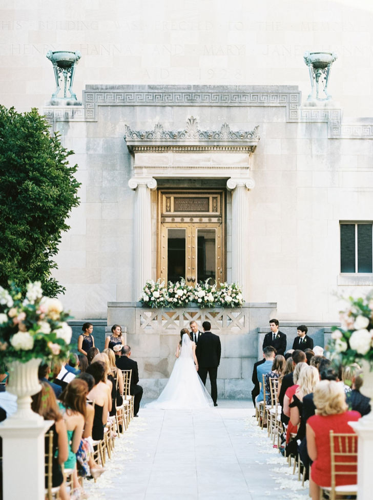 A wedding couple is getting married at the Cincinnati Art Museum in Ohio.