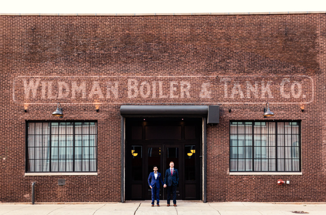 A wedding couple is standing in front of the Wildman BT, one of the wedding venues in Illinois.