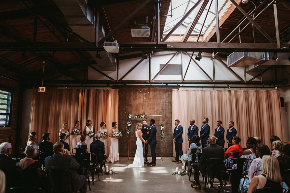 A wedding couple is getting married at the Ovation wedding venue in Chicago, Illinois.
