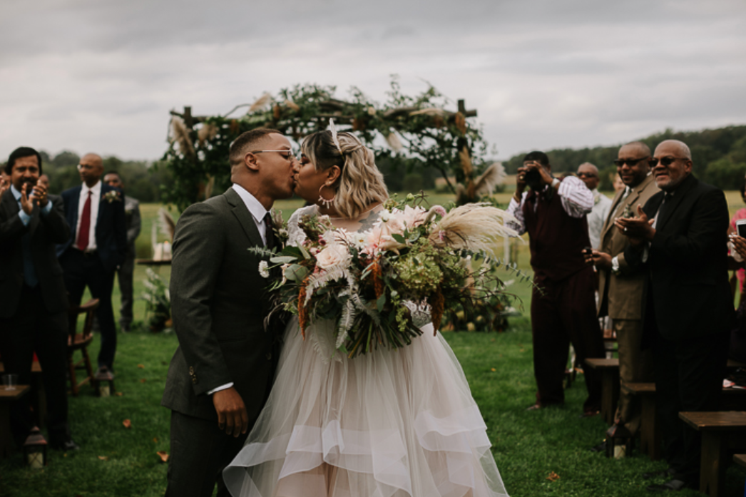 A wedding couple is kissing each other at the Locust Hall Farm in Jobstown, New Jersey.