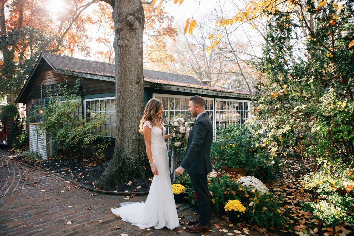 A wedding couple is standing at the Historic Smithville Inn in New Jersey.