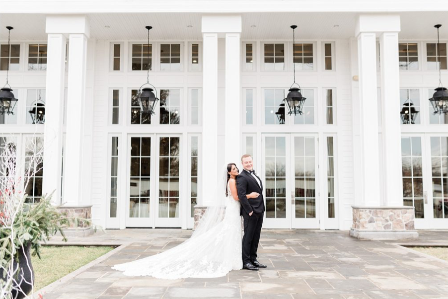 A wedding couple is holding each other at the Ryland Inn in New Jersey.