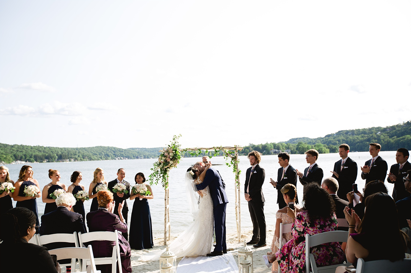 A wedding couple is getting married at the beach at LakeMohawk Country Club in Sparta, New Jersey.