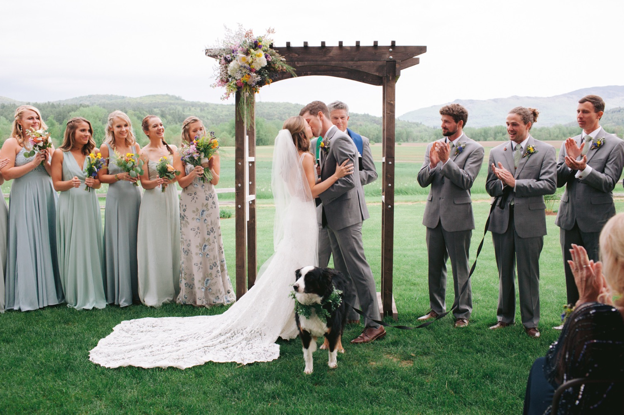 A wedding couple is kissing each other at the Bar at Boyden Farm in Vermont.