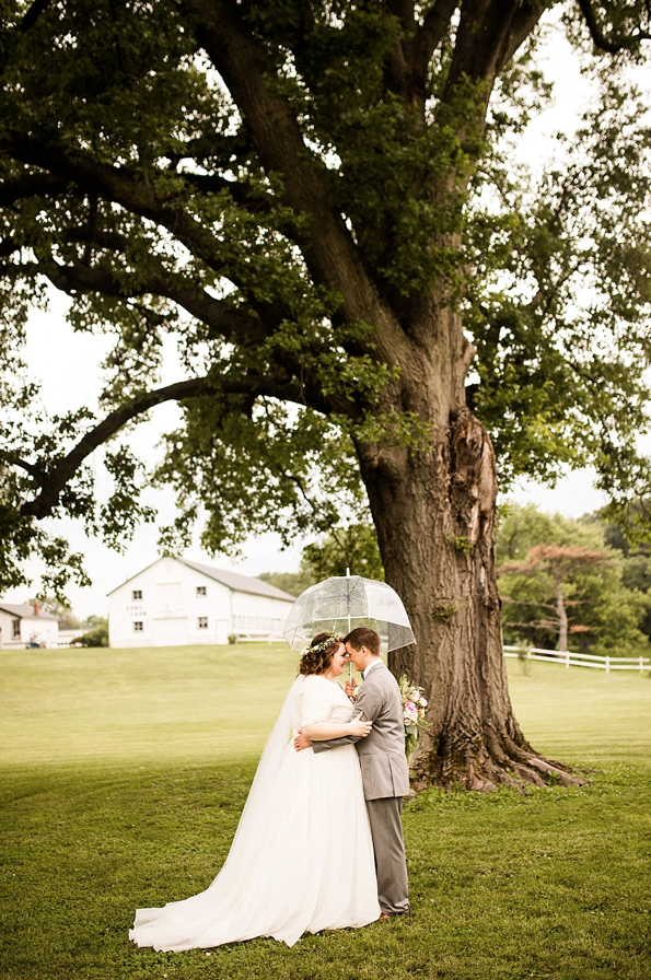 A wedding couple is holding each other at the Kuss Estate and Farm in Missouri.