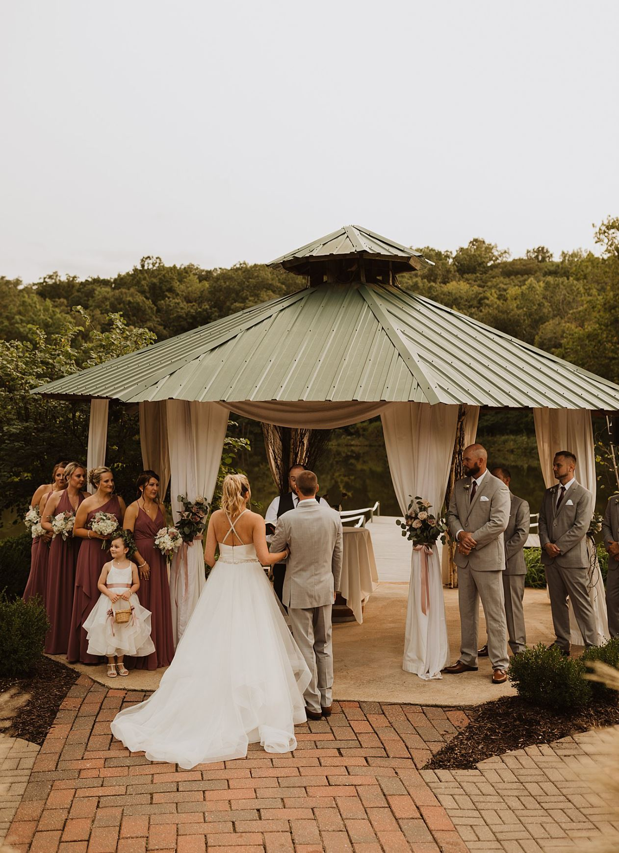 A wedding couple is getting married at the lake at the Little Piney Lodge in Missouri.