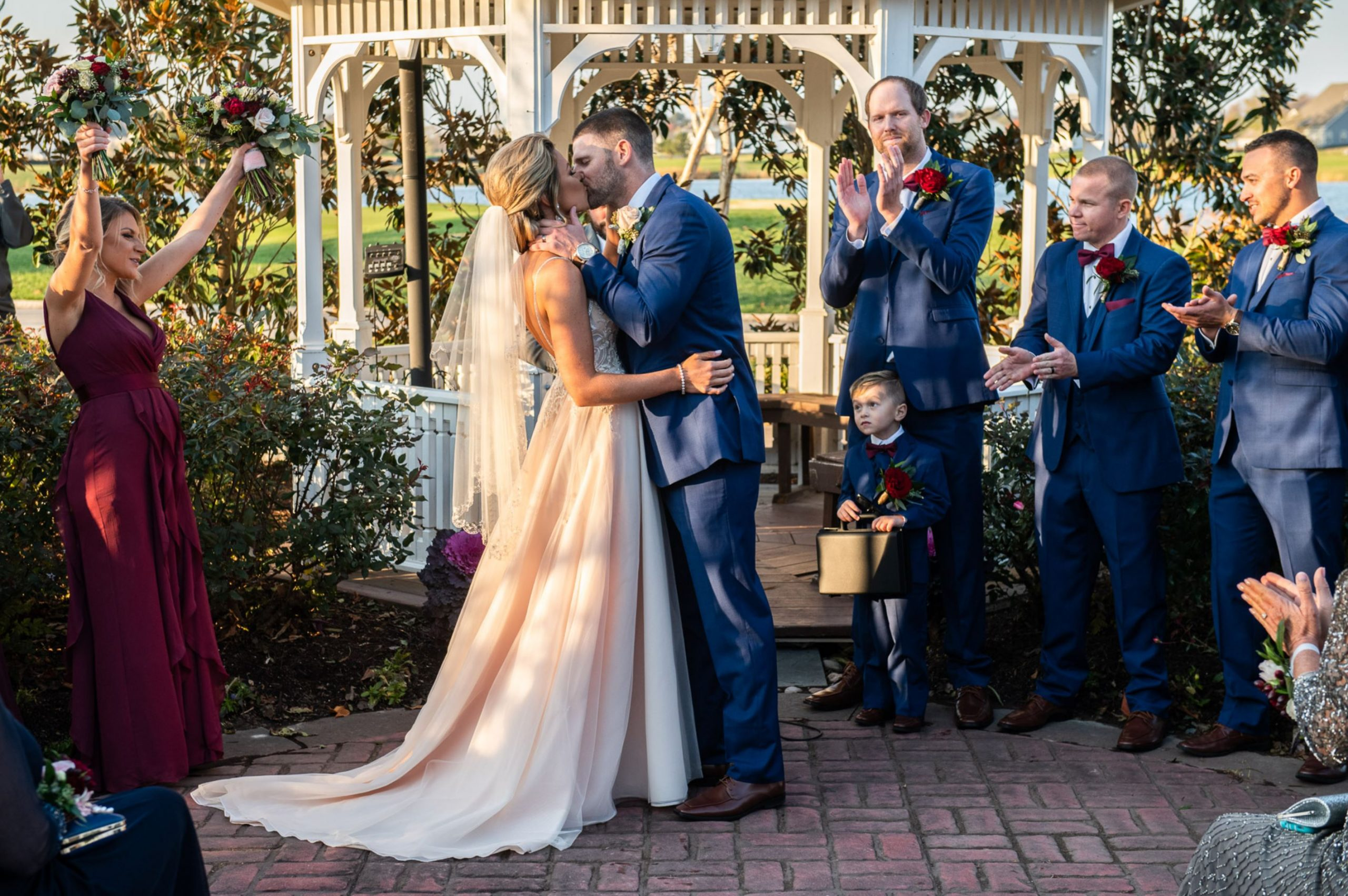 A wedding couple is kissing each other at the Heritage Shores Club in Delaware.