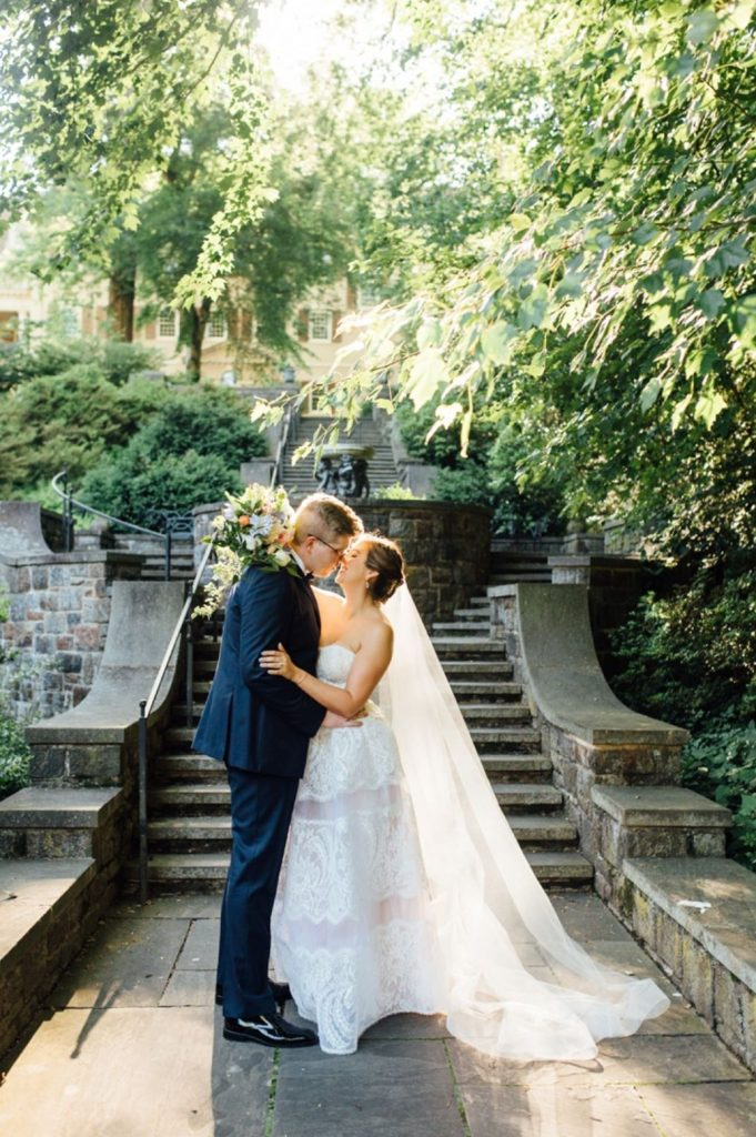 A wedding couple is about to kiss at the Winterthur estate in Delaware.