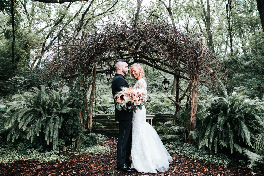 A wedding couple is holding each other at the Camrose Hill Flower Farm in Minnesota.