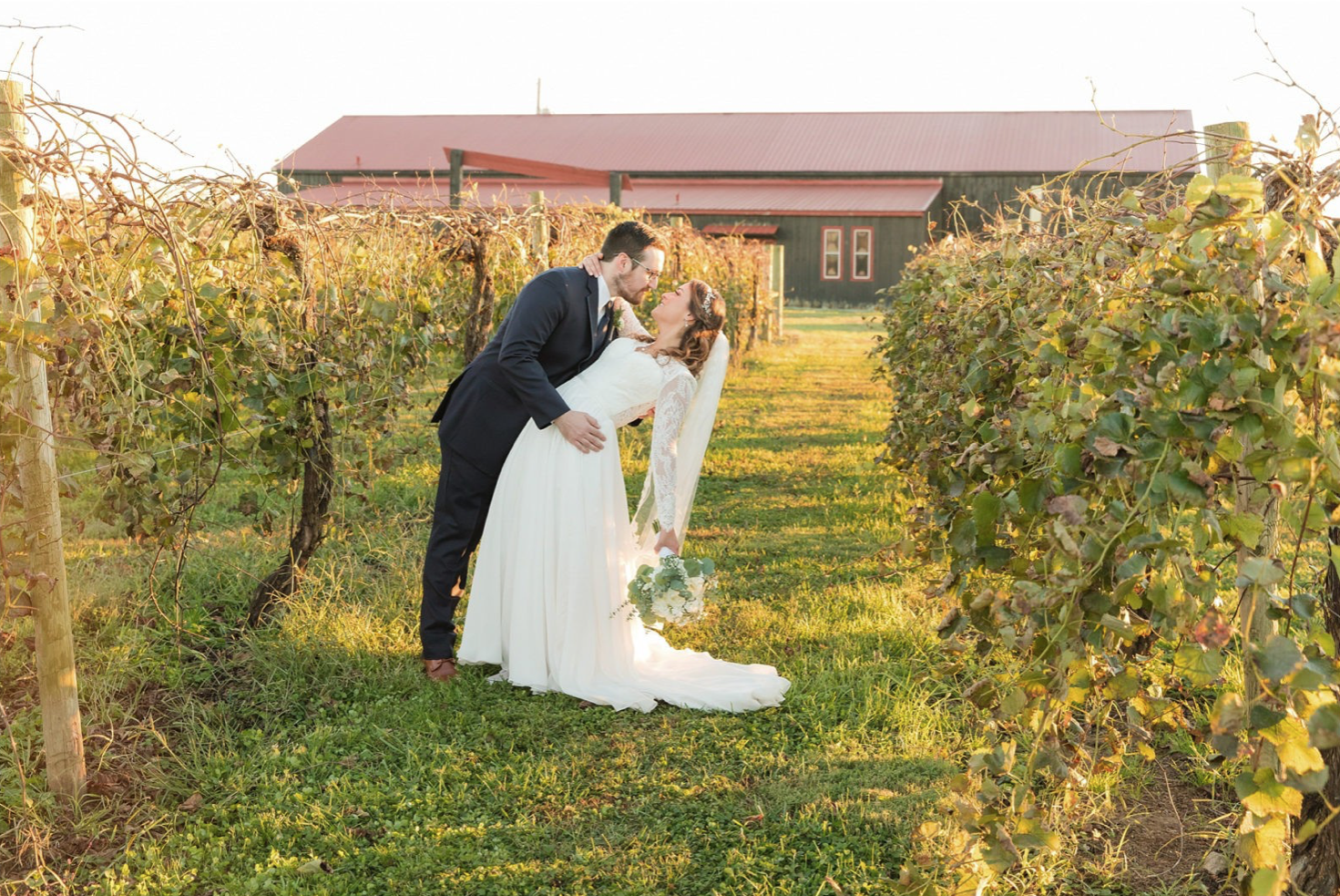 A wedding couple is kissing each other at the Talon Winery in Kentucky.
