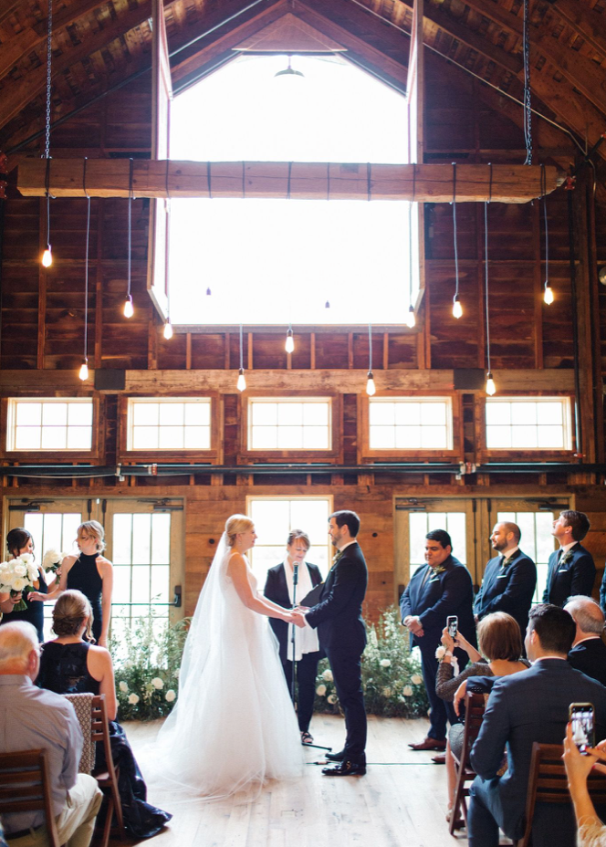 A wedding couple is getting married at the Firelight Farm.