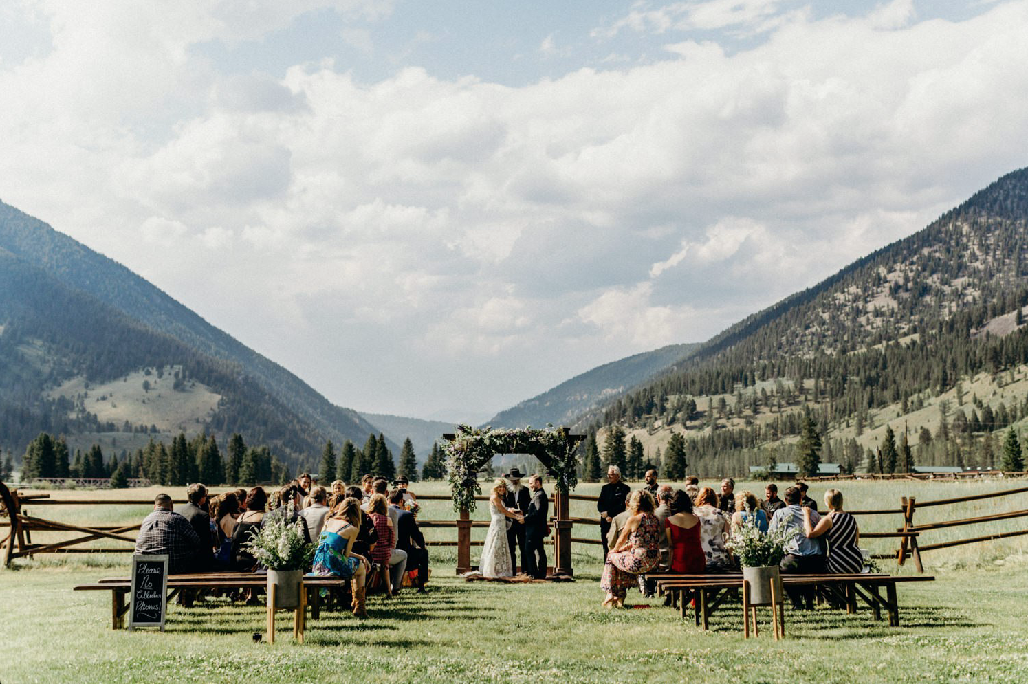 A wedding couple is getting married in a valley at the 320 Montana Guest Ranch.
