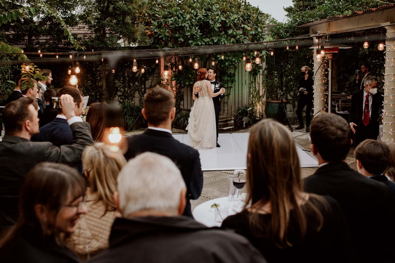 A wedding couple is having their first dance.