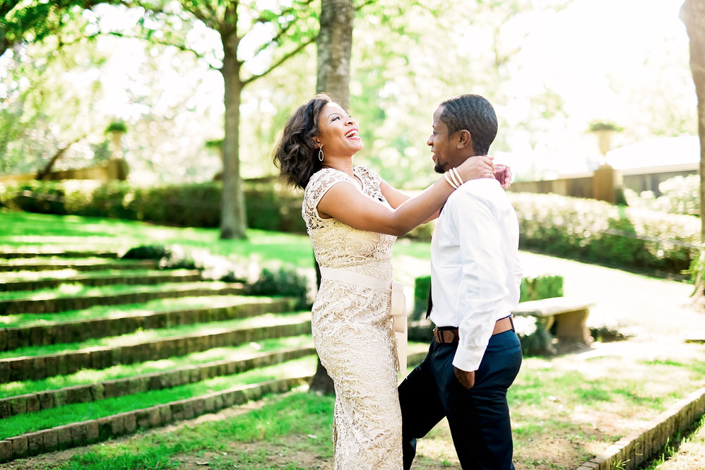 A wedding couple is holding each other at the Bayou Bend Collection and Gardens.