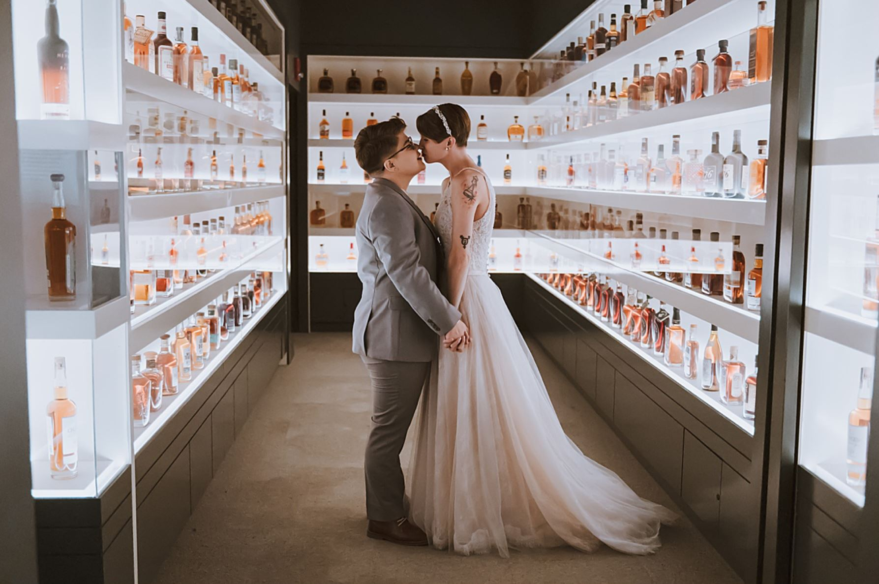 A wedding couple is kissing each other at the Francier HIstory Museum.