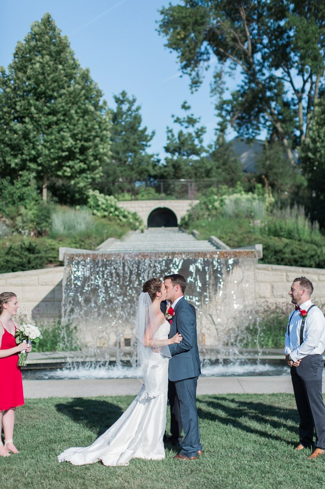 A briode and a groom are kissing each other in Iowa.